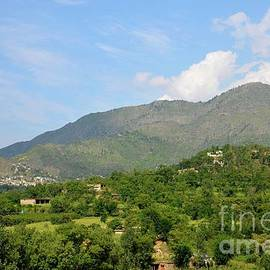 Imran Ahmed - Mountains sky and homes in village of Swat Valley Khyber Pakhtoonkhwa Pakistan