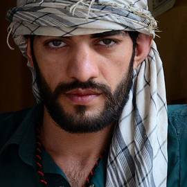 Imran Ahmed - Pakistani Pashtun man models with headscarf and necklace Peshawar Pakistan