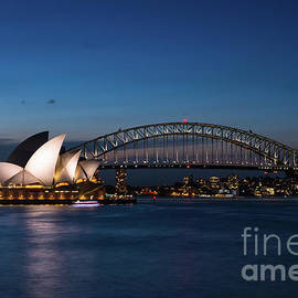 Sydney Opera House and Harbour bridge after sunset  by Andrew Michael