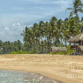 Tropical beach with low key restaurant by Patricia Hofmeester