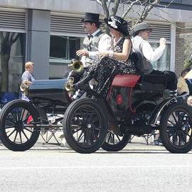 A 1901 Oldsmobile Convertible With Passengers by John Telfer
