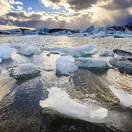 Ice in Jokulsarlon Lagoon by Alexey Stiop