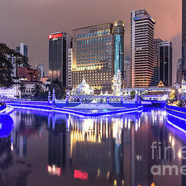 The Office Buildings Reflects In The Water Of The Klang River In by Didier Marti