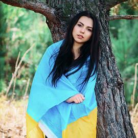 Oleksandr Masnyi - Beautiful brunette model posing in a park with  flag of Ukraine