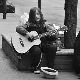 Carmen Gonzalez - A boy and his guitar