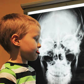 A Boy Disapproves of an  X-ray at the Discovery Children's Museu by Derrick Neill
