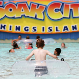 A Boy in a Transparent Lifesaver at Soak City, Kings Island by Derrick Neill
