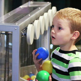 A Boy's Look of Wonder at the Discovery Children's Museum, Las V by Derrick Neill
