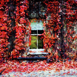 Amy Cicconi - A building covered with vining red leaves