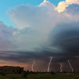 A Dance of Five Lightning Bolts at Sunset by Derrick Neill