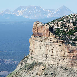 A Fire Scorched Mesa Verde with Alpine Peaks Behind by Derrick Neill