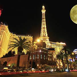 A full moon over Paris, Las Vegas, Nevada, USA by Derrick Neill
