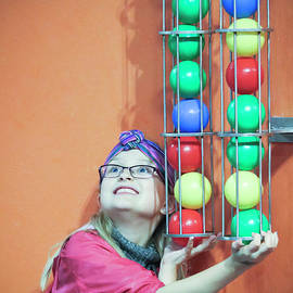 A Girl Plugs the Ball Shoot at the Discovery Children's Museum,  by Derrick Neill