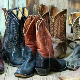 A Group of Ten Pairs of Old Cowboy Boots by Derrick Neill