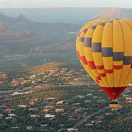 A Hot Air Balloon Soars Above Sedona, Arizona by Derrick Neill