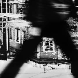 A man walks down the street by   larisa Fedotova