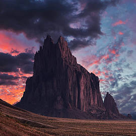 A Shiprock Landscape Against a Breathtaking Twilight Sky by Derrick Neill