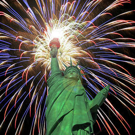 A Statue of Liberty Fourth of July Fireworks Celebration by Derrick Neill