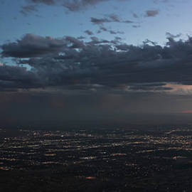 A Thunderstorm at Dusk Over Albuquerque, New Mexico by Derrick Neill