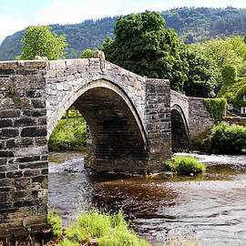 A View of Pont Fawr and Tu Hwnt Ir Bont, Wales, UK  by Derrick Neill
