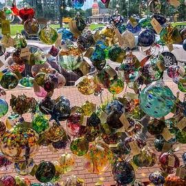 Mark Sellers - A Window Full Of Blown Glass Globes at a gift shop in New England