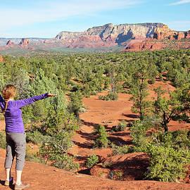 A Woman Rejoices in the Sedona Beauty, Arizona by Derrick Neill