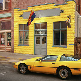 A Yellow Sports Car and a Yellow Building by Derrick Neill