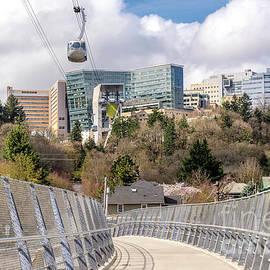 Gino Rigucci - Aerial tram transporting people in Portland Oregon.