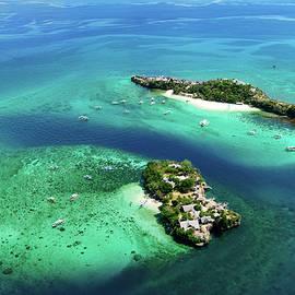 Elena Riim - Aerial view of tropical island.