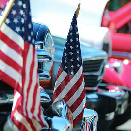 American Flags and Chrome at a Car Show by Derrick Neill