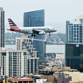 An American Jet on Approach Over Downtown San Diego, CA, USA by Derrick Neill