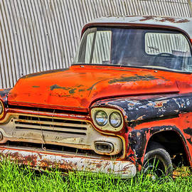 An Old Chevy Pickup Truck in a Junkyard  by Derrick Neill