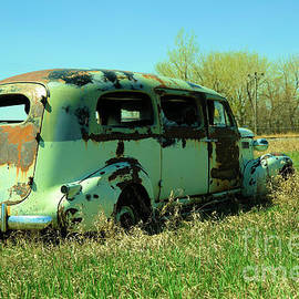 An old van in the bushes by Jeff Swan
