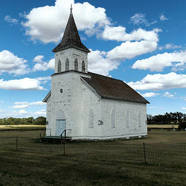 An old wooden church by Jeff Swan