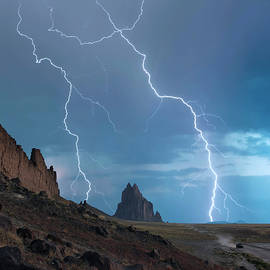 An SUV Races Away from a Thunderstorm at Shiprock, New Mexico by Derrick Neill