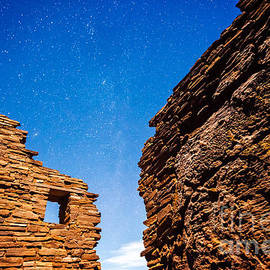 Ancient Native American Pueblo Ruins And Stars At Night by Bryan Mullennix