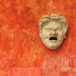 Angry stone face of white man by Patricia Hofmeester