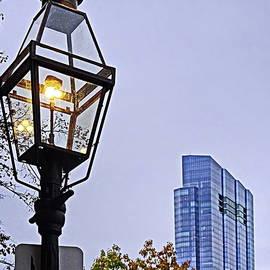 Antique Gas Lantern and Modern Skyscraper. by Lyuba Filatova