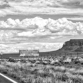 Thomas Woolworth - Approaching Monument Valley Signage BW