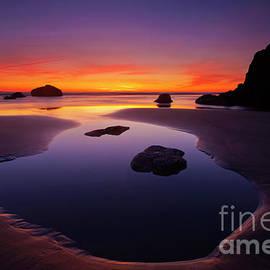 Arcadia Beach Reflections by Mike Dawson