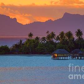 as the sun sets in Bora Bora by Kris Hiemstra
