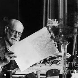 Austrian psychoanalyst Sigmund Freud in his office in Vienna - Austrian School