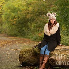 Autumn Woman On Log - Amanda Elwell