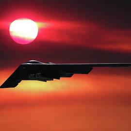 B-2 Stealth Bomber in the Sunset by Erik Simonsen