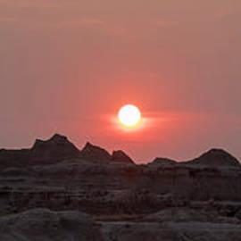 Badlands Sunset by Jim West