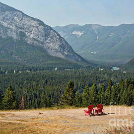 Banff Red Chairs With Majestic Mountains by Carol Groenen