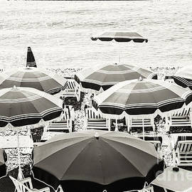 Beach umbrellas in Nice by Elena Elisseeva