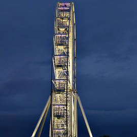 Big Wheel Lit Up At Dusk by Jeremy Hayden