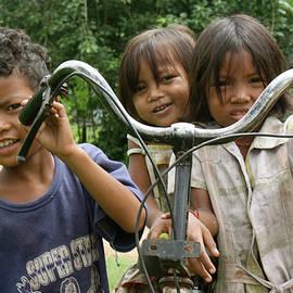 Bike Riders by John Meader