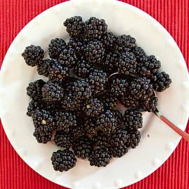 Blackberries on a plate by Tatiana Travelways